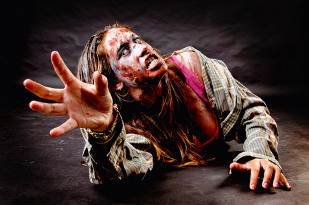 creepy monster: zombie isolated in black background Stock Photo