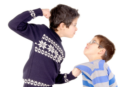 little boy bullying classmate isolated in white