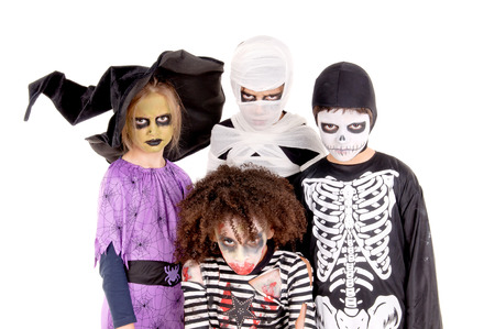 group of little kids with scary costumes on halloween isolated in white photo