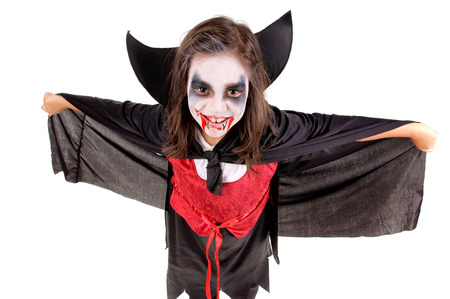 beautiful vampire: little girl dressed as a vampire on halloween isolated