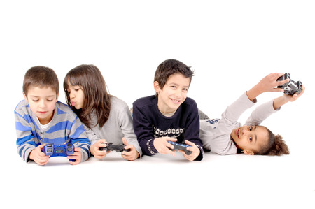 handheld computer: group of friends playing videogames isolated in white background Stock Photo