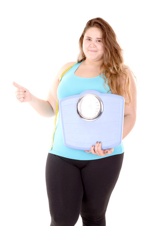 large girl in fitness outfit isolated in white background photo