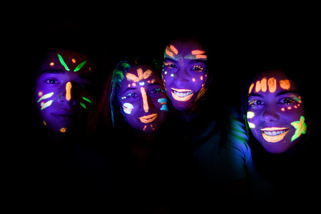 group of friends with faces painted at a party photo