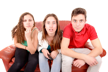watching movie: friends sitting on a couch isolated in white background