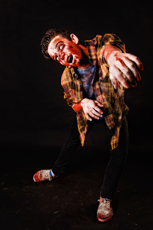 zombie isolated in dark background