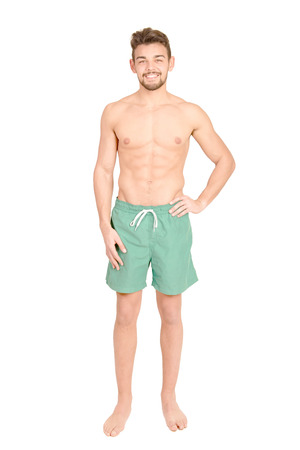 handsome man with beach shorts isolated in white