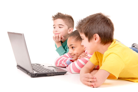computer isolated: little kids with computer isolated in white background