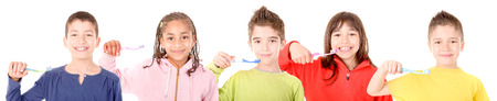 Little boy brushing teeth isolated in white Stock Photo