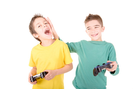 Little boys playing videogames isolated in white Stock Photo