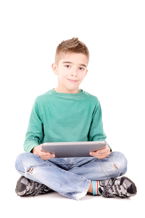 Little boy with tablet isolated in white