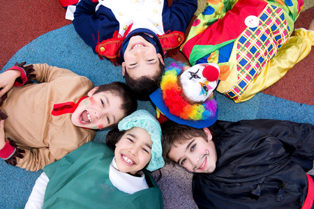 little kids in costumes on halloween having fun together