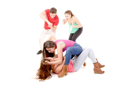 teenagers bullying a girl isolated in white background photo