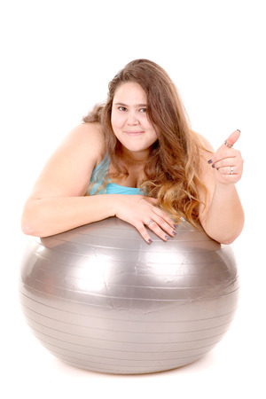 gluttonous: large girl in fitness outfit isolated in white background