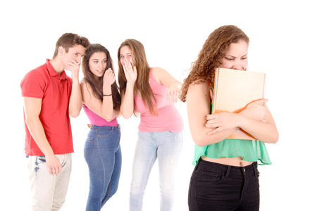teenagers bullying a girl isolated in white background Stock Photo