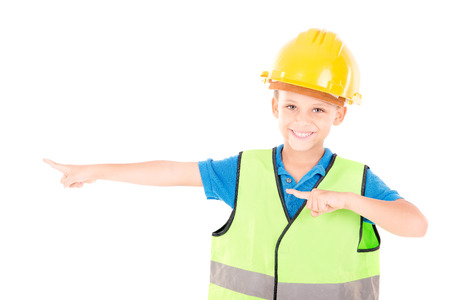 constable: little boy pretending to be a contruction worker isolated in white Stock Photo