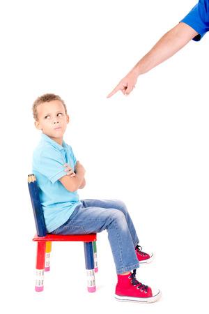 niños malos: niño está punnished aislado en blanco Foto de archivo