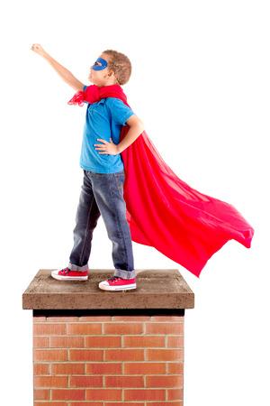 ni�os tristes: ni�o pretendiendo ser un superh�roe Foto de archivo