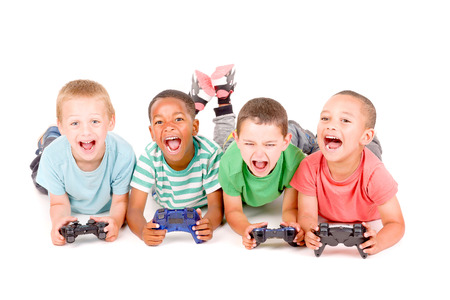 handheld computer: little boys playing videogames isolated in white background