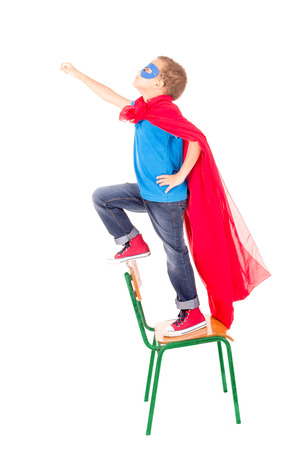 superhero: little boy pretending to be a superhero