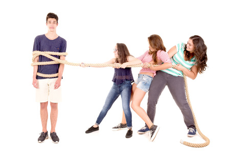 toiling: teenagers playing the rope game isolated in white