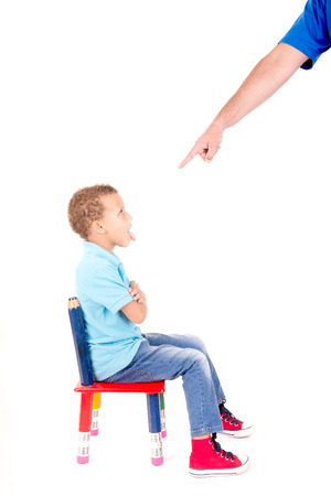 little boy being punnished isolated in white