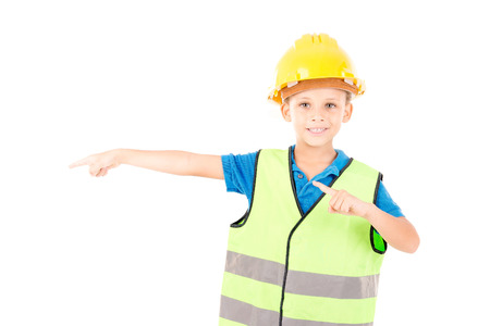 warden: little boy pretending to be a contruction worker isolated in white Stock Photo