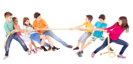 toiling: little kids playing the rope game isolated in white