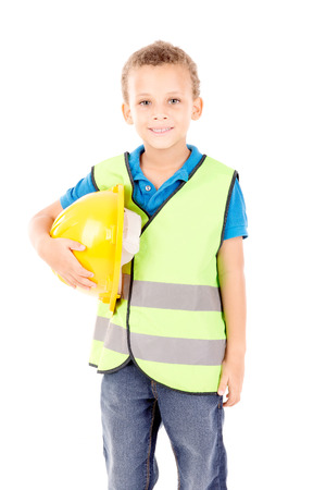 traffic warden: little boy pretending to be a contruction worker isolated in white Stock Photo