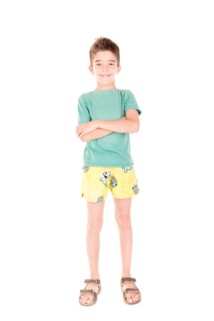boardshorts: little boy with beach shorts isolated in white background