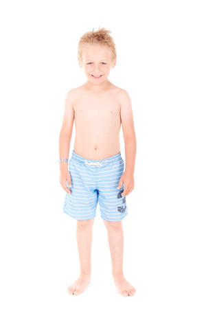 swimming shorts: little boy with beach shorts isolated in white background