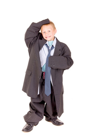 little boy in father suit isolated in white background
