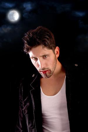 handsome vampire isolated in dark background