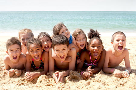 swimming shorts: little kids at the beach Stock Photo