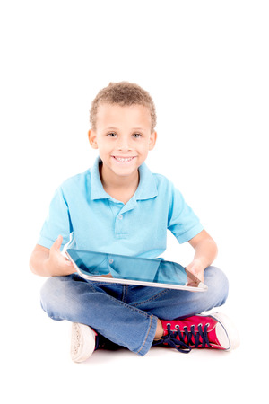 family with one child: little boy playing with tablet isolated in white