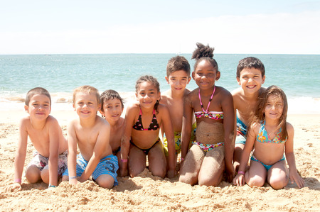 little kids at the beach Stock Photo