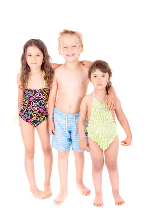 beach clothes: little kids with beach clothes isolated in white background Stock Photo