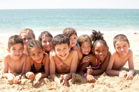 board shorts: little kids at the beach Stock Photo