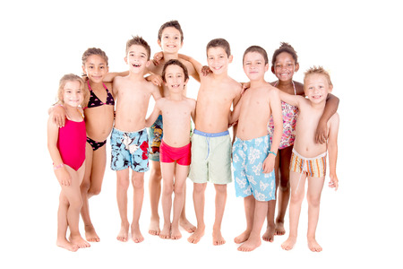 little kids with beach clothes isolated in white background Stock Photo