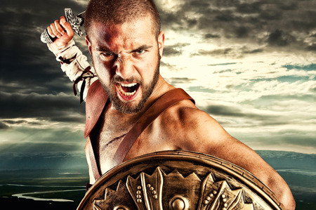 strong gladiator isolated on sky background