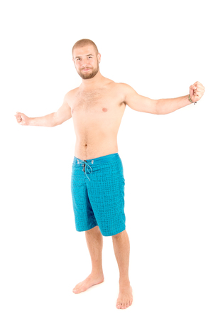 boardshorts: handsome young man isolated in white background Stock Photo