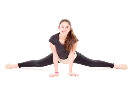 young gymnast: young gymnast isolated in white background