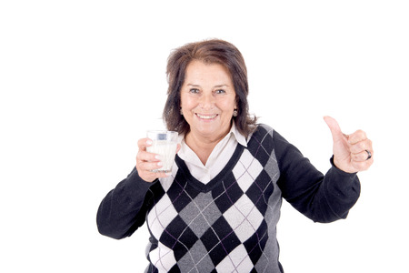 amiable: beautiful senior woman with glass of milk isolated in white Stock Photo