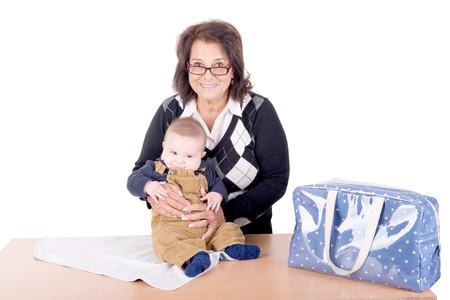 grandaughter: grandmother with little grandson isolated in white