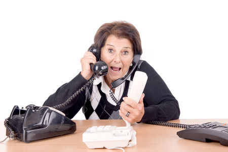 senior beautiful woman with telephones isolated in white