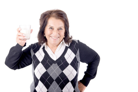beautiful senior woman with glass of milk isolated in white Stock Photo