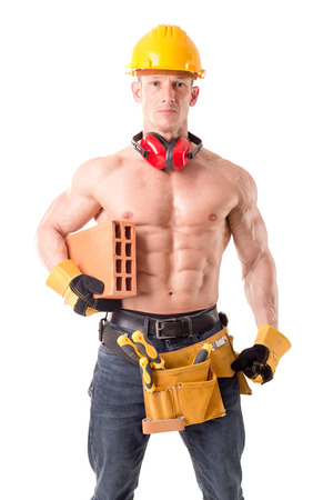 handsome construction worker posing isolated in white Stock Photo