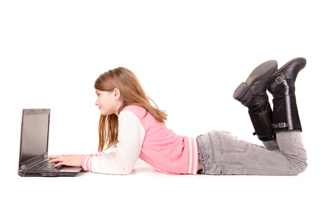 little girl with computer isolated in white background photo