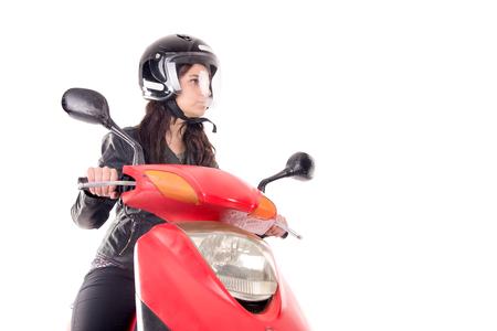 mujer joven con motocicleta aislada en blanco Foto de archivo