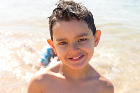 little boy posing at the beach Stock Photo