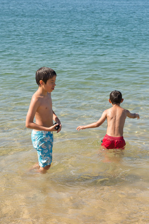little kids posing at the beach Stock Photo